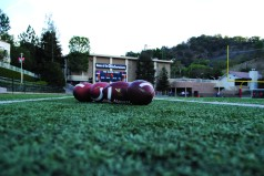 Footballs used for the Homecoming game sits on the field. Credit: Casey Kim '20 / SPECTRUM