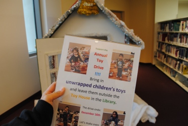 Annual toy drive poster with house in the background Credit: Caitlin Chung '20/SPECTRUM