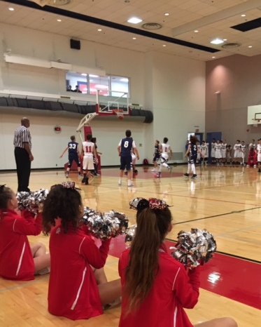 The Middle School cheer team cheers on the basketball team as they run down the court. Credit: Lauren Nehorai '20/SPECTRUM