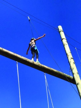 A student walks the high ropes challenge in El Capitan Canyon. Credit: Emma Limor '21 / SPECTRUM