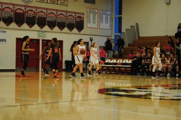 JV squad walks to team bench during a timeout. Credit: Casey Kim'20/SPECTRUM